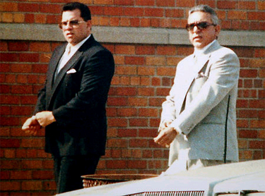 Charlie Carneglia (right) walking with John Gotti Jr., outside a funeral home.